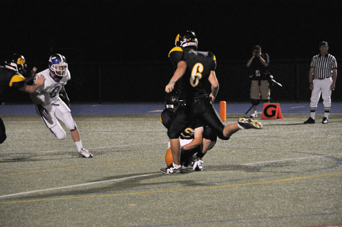Nick Visco kicking for Archbishop Wood.