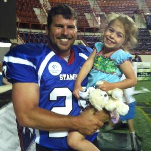 Cap Poklemba after winning indoor football league title for Harrisburg pro team this season (with his rugrat).