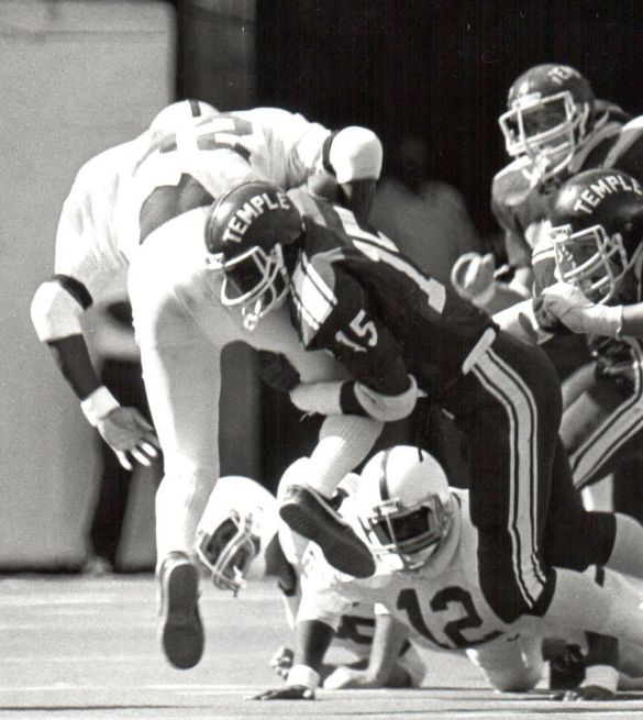 Click on the photo of Todd making a tackle for Temple for more.
