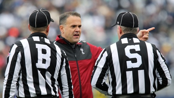Click on the photo of two refs telling Matt Rhule what they think calling a timeout on fourth and 20 prior to a punt is ....