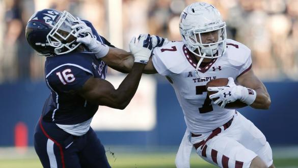 Temple wide receiver John Christopher (7) stiff-arms first-round NFL draft choice Byron Jones (16)